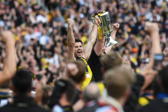 Trent Cotchin and Damien Hardwick lift the premiership cup.