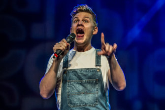 Joel Creasey on stage at last year's Canberra comedy gala.