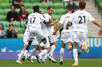 Angus Thurgate (centre) celebrates with Jets teammates after scoring against Melbourne Victory on Sunday.
