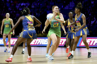 Steph Wood (centre), pictured here in action at last year's Netball World Cup, was crucial in the Lightning's win.