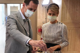Syrian President Bashar al-Assad casts his ballot in parliamentary elections, with his wife Asma, on July 19.