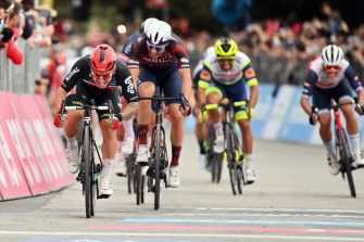Caleb Ewan (left) sprints to victory in stage seven of the Giro d'Italia.