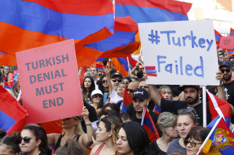 Crowds of Armenian Americans march in Los Angeles in 2019 during the annual commemoration of the deaths of 1.5 million Armenians under the Ottoman Empire. Turkey contends the deaths were due to civil war and unrest.