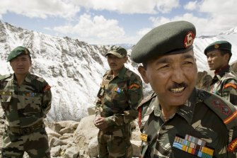 """Members of the Ladakh Scouts infantry regiment – nicknamed the """"Snow Warriors"""" – at Khardung La, a mountain pass in the Ladakh Himalayas on September 12."""
