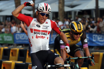 Caleb Ewan, left, wins the final stage of the Tour de France, an unofficial world championship for sprinters.