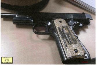 The diamond-encrusted pistol, monogrammed with his initials JGL - Joaquin Guzman Loera.