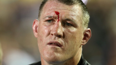 Rotten night at the office: Paul Gallen watches from the sideline in his last NRL game.