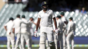Procession: Ravi Ashwin walks from the field after being dismissed by Pat Cummins.