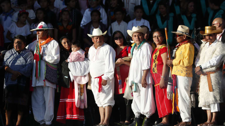 Indigenous religious leaders wait for Mexico's new President Andres Manuel Lopez Obrador for a traditional indigenous ceremony at the Zocalo, in Mexico City, on Saturday.