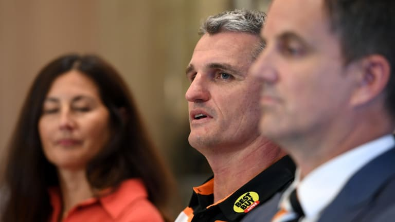 Playing hard ball: West Tigers chief Justin Pascoe (front) will fight to keep Ivan Cleary (centre).
