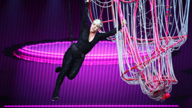 Pink swings from the chandelier in her show in Sydney on Saturday.