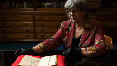 Maggie Patton, chief curator at the  State Library of NSW, with a 1516 letter containing a drawing of the Southern Cross, thought to be the oldest European depiction.