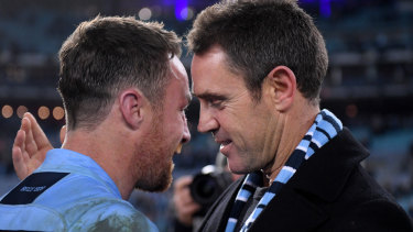 Reunited and it sort of feels so good ... James Maloney and Brad Fittler after winning last year's series.