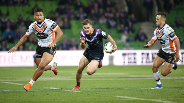 Flyin' Ryan: Melbourne's first tryscorer Ryan Papenhuyzen hits a gap.