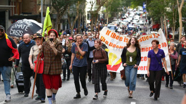 While some people held environmental banners, the march aimed to reinforce people's right to protest.