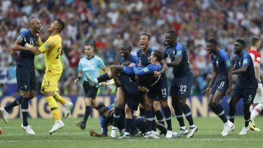French players celebrate at the end of the match.
