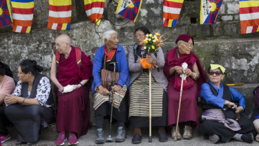 Tibetan and Buddhist flags decorate the streets in Dharmsala, as exiled Tibetans await the return of their spiritual leader.
