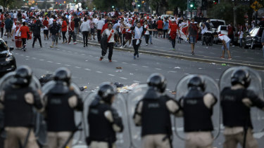 River Plate fans clash with riot police outside the Antonio Vespucio Liberti stadium prior to the scheduled match.