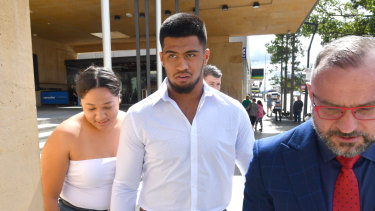 Brisbane Broncos NRL player Payne Haas (centre) is seen leaving the Ipswich Magistrates Court in Ipswich.