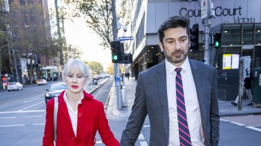 onstantine Arvanitis outside Melbourne's County Court with his fiancee, Melanie Thornton, after the first day of his defamation trial against former partner Selina Holder.