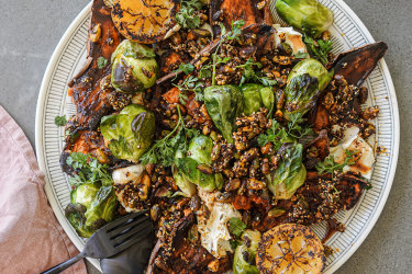 Charred spiced sweet potato and brussels sprouts with labne, lemons and crunchy bits.
