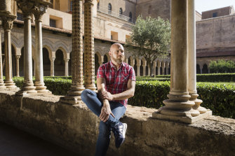 Francesco Lepore, a Latin expert, gay rights activist, journalist and former Catholic priest, at the Benedictine Cloister in Monreale, Italy.