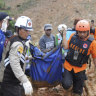 Indonesian landslide kills dozens, wipes away houses