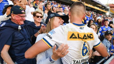 Michelle Arthur shares a special moment with her son Jakob after the 18-year-old scored a try on debut in Brisbane on Sunday.