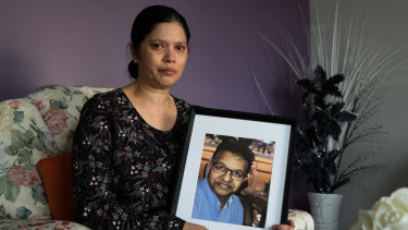 Sharmil Maharaj with a portrait of her late husband, Praween Maharaj. He was a nurse in the mental health unit at Liverpool Hospital, whose death at work is currently under investigation.