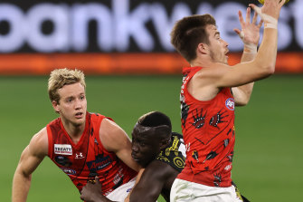 Darcy Parish (left) and Zach Merrett (right) have formed a formidable combination for the Bombers.