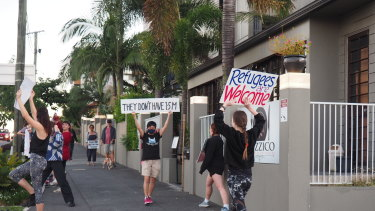 Community members arrive at the makeshift detention centre in Brisbane each Friday to protest.