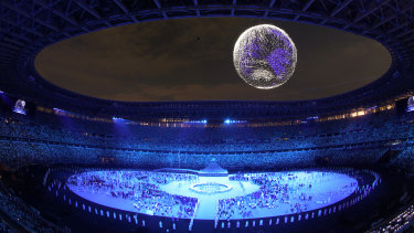 A drone display of the Tokyo Games emblem is seen over the top of the stadium during the opening ceremony.