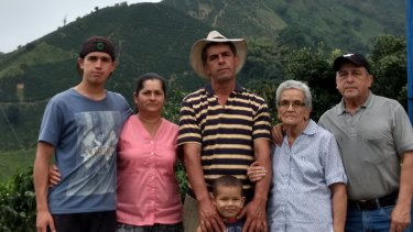 Four generations of coffee growers outside Chinchina, Caldas, Colombia.(right to left): Farm co-owner Mario De Jesús Murillo Benjumea, his mother Griselda Benjumea, Mario's brother and business partner Carlos Duvan Murillo and Carlos's children and wife: Emanuel Murillo, Carmen Alzate  and Germán Murillo.