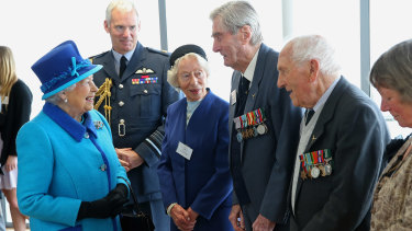The Queen meets Mrs K Foster (left), wing commander Paul Farnes (centre) and squadron leader Tom Pickering in 2015.