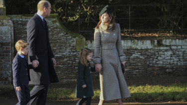 Prince George, 6, and Princess Charlotte, 4, walk hand-in-hand with their parents, Prince William and Catherine, the Duchess of Cambridge,