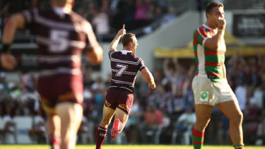 Golden boy: Daly Cherry-Evans celebrates after kicking the winning field goal against Souths in round four.