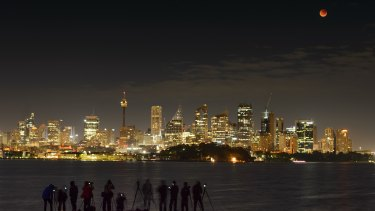 Photographers capture the blood moon over Sydney's skyline.