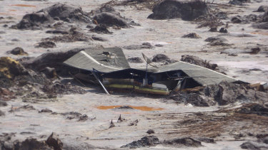 A structure is buried in mud in the Bento Rodrigues valley after BHP-Vale's Samarco dam failure in 2015.