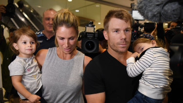 In the eye of the storm: David and Candice Warner return to Sydney with their children in the wake of the ball-tampering scandal.