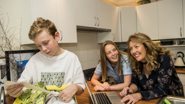 Felicity Waterford with her children Olivia and Josh going through their receipts and the online budget.