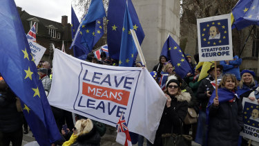 Protesters gathered in London on Tuesday as the UK Parliament was set to vote on competing Brexit plans.