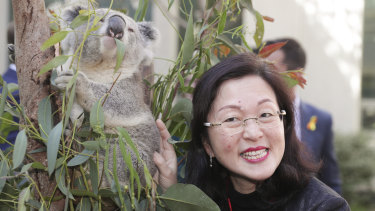 Liberal MP Gladys Liu poses with a koala during an event to mark National Threatened Species Day on Tuesday.