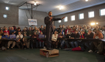 "Obama fronts a town hall meeting in a gym in Davenport, eastern Iowa, on January 1, 2008. ""No one could see him, so his staff found a wooden crate and made it into a stage,"" says Shell."