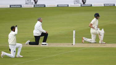 England and West Indian players and the umpires take the knee at the start of the first Test last year.