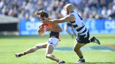 Callan Ward injures his knee against Geelong in round four last year.
