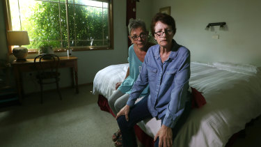 Lynda Henderson, left, who cares for Veda Meneghetti, who has early onset dementia, at home.