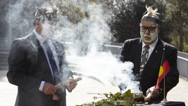 Douglas Milera (left) and Professor Peter Buckskin during a repatriation ceremony in London on Tuesday.