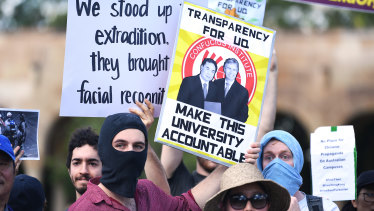 Students hold placards during a protest at the University of Queensland last month. Hundreds gathered to protest against funding agreements between Australian universities and Chinese government-funded education organisations in Queensland.