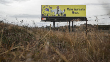 A Clive Palmer billboard on the Federal Highway in the lead up to the federal election.