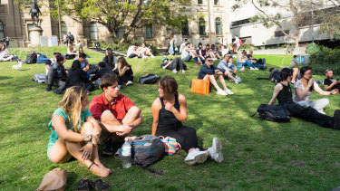 People on the lawn (pre-lockdown) in front of Melbourne's State Library.
